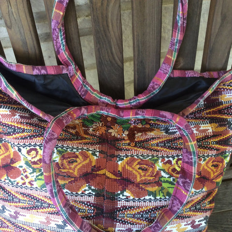 handwoven market bag/tote. Made with an original huipil, Mayan blouse.. Zippered compartment inside and open pouch. Nice metallic threads.