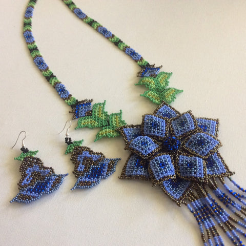 Classic Huichol hand beaded necklace.Blue and bronze colored seed beads.