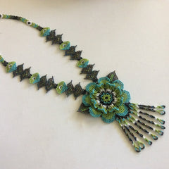 Gorgeous and classic! Hand beaded Huichol necklace.