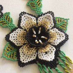 Hand beaded Huichol necklace with color combination black, gold, with a splash of green