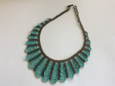 Beautiful hand beaded, turquoise and bronze colors glass bead necklace.