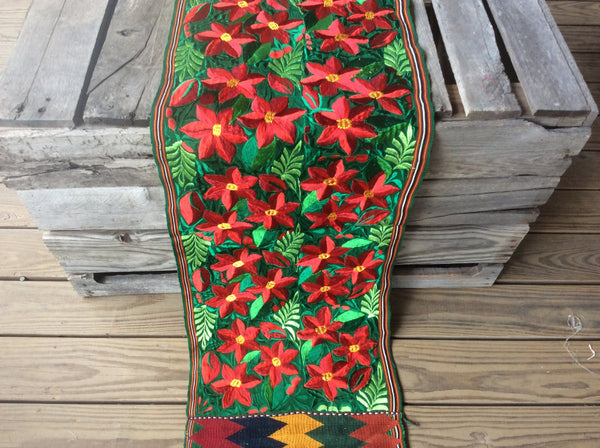 Beautiful, woven Christmas table runner. Gorgeous poinsettias make a WOW statement.
