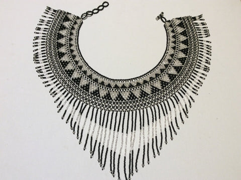 Beautiful, hand beaded necklace with collar style with fringe.