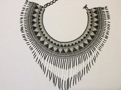 Beautiful, hand beaded necklace with collar style with fringe
