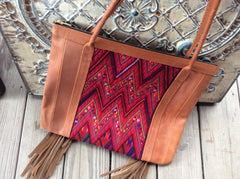 Hand stitched Boho top grain leather fringed tote bag with accented handwoven fabric