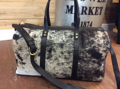 Gorgeous handmade hair on cowhide duffle bag.