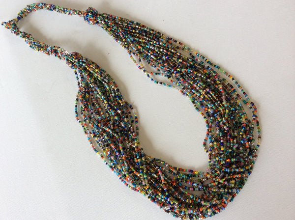 Colorful, long hand beaded necklace made in Santiago Atitlan Guatemala