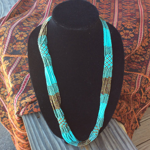 Turquoise and bronze colored glass seed beads