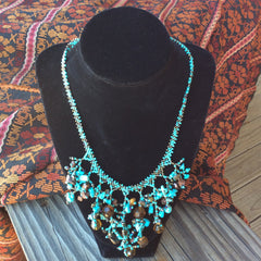 Hand beaded coral drop necklace made in Guatemala