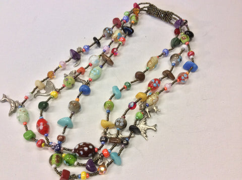 Hand beaded magnetic clasp necklace with Milagros