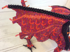 Hand beaded, seed bead dragon, by master beading artist in Santiago Guatemala.