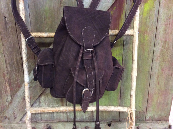 Chocolate brown leather backpack with easy magnetic clasp under buckles.