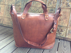 Soft chocolate brown leather, oil rubbed top grain leather weekender/ luggage.