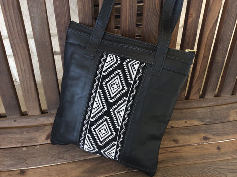 Gorgeous, sophisticated, black leather tote with beautiful hand beaded panel.