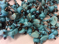 Gorgeous turquoise and bronze hand beaded statement necklace