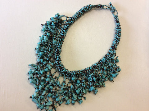 Gorgeous turquoise and bronze hand beaded statement necklace.