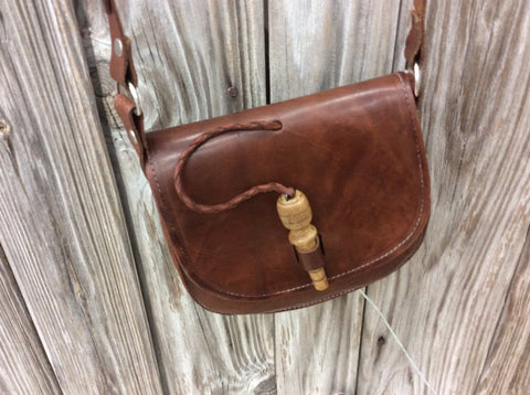 Hand made leather cross body purse hand  laced, fun style and will last a lifetime.