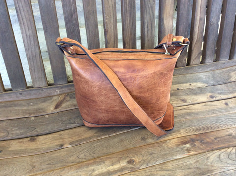 Beautiful, top grain leather, hand made purse/ mini tote. Oil rubbed leather, satchel style bag. Unsurpassed quality, truly a lifetime bag.