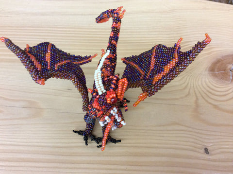 Hand beaded dragon. Truly a piece of intricate art.