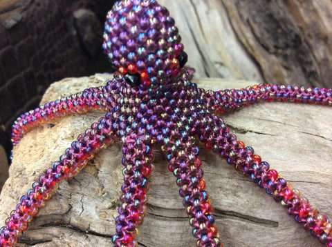 Adorable hand beaded glass seed beads are hand strung octopus