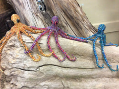 Adorable hand beaded glass seed beads are hand strung octopus.