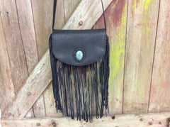 Black leather hand made purse with fringe with jade stone closure.