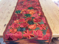 Beautiful table runner, floral design in gold, red, orange and brown tones.