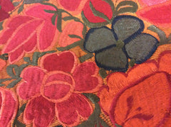 floral design in gold, red, orange and brown tones