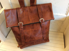 Fabulous, hand made top grain leather backpack. Unisex. Great design. Leather lined.