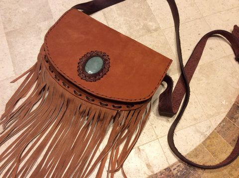 Leather fringed cross body purse embellished with a gorgeous jade stone.