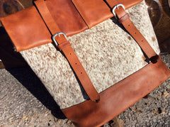 Hand made, oil rubbed, top grain leather and cowhide backpack.