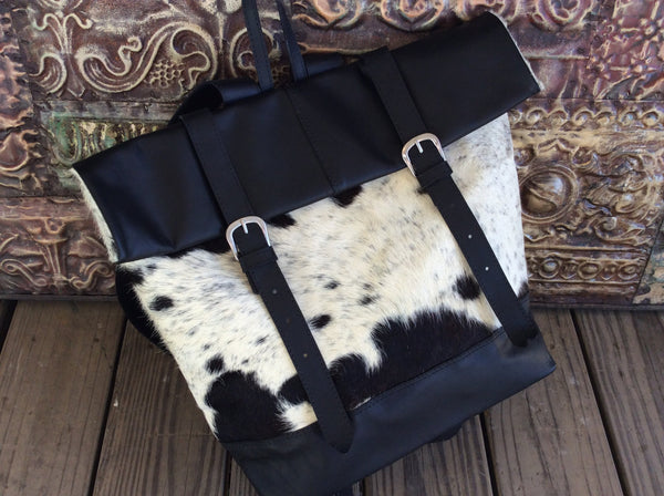 Black and white, leather, cowhide backpack/ travel bag.