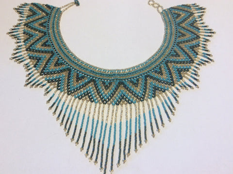 Gold, turquoise and iridescent beads collar/ bib style hand beaded necklace.
