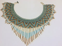 Beautiful, hand beaded collar style necklace with fringe accents.