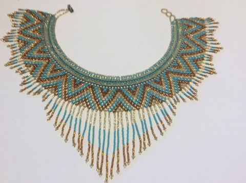 Beautiful, hand beaded collar style necklace with fringe accents