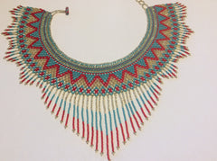 Beautiful hand beaded necklace and styled like a collar.