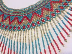 Beautiful hand beaded necklace and styled like a collar