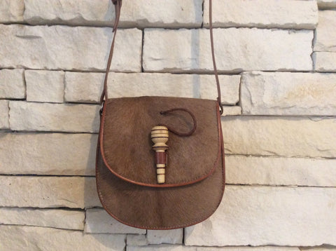 Brown cowhide leather purse with hand carved wooden dowel closure
