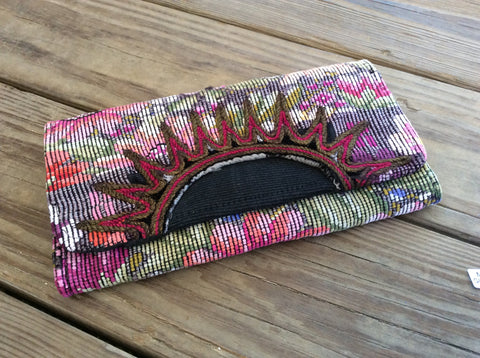 Handwoven clutch/ purse. Multi compartment, magnetic closure. Made with an original Mayan huipil, backstrap woven blouse.