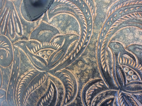 This gorgeous hand tooled leather could be used as a large purse, a tote bag