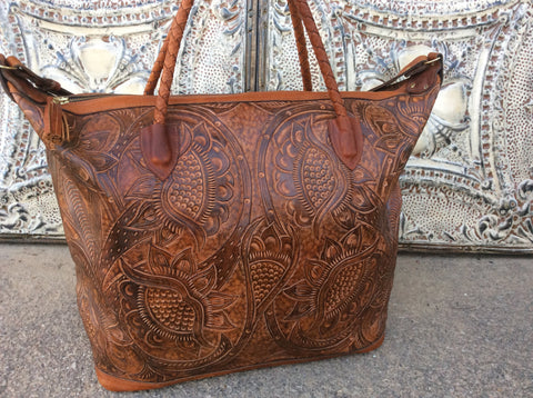 Hand braided top handles, hand tooled leather x large weekender.