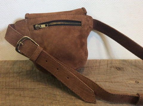 Hand made using the highest quality nubuck leather. Multiple compartments.