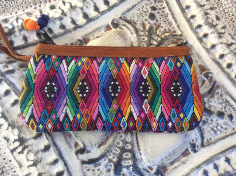 Handwoven/nubuck leather wristlet. Beautiful fabric made on a blackstrap loom. Accented with nubuck leather. Wrist pouch.