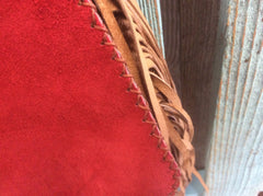 Beautiful, top grain leather crossbody purse. Red and brown leathers accented with a gorgeous hand beaded medallion.