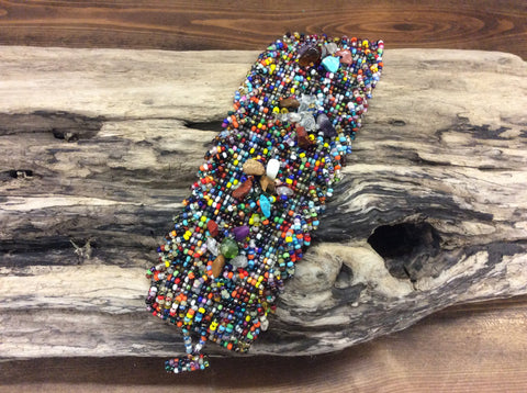 Confetti multi hand beadedcolor bracelet accented with crystals.