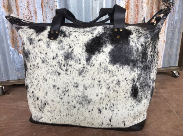 Black top grain leather finish spotted cowhide weekender/ large tote bag.