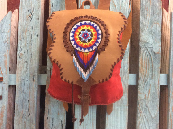 Beautiful and very stylish leather fringed, handwoven backpack.