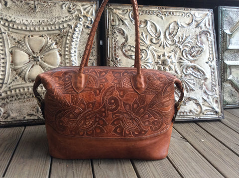 Top grain caramel color leather hand tooled leather hand made leather weekender.