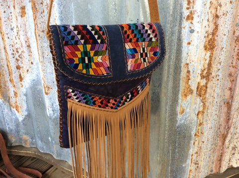 Leather fringed purse handwoven huipil and finished with top grain hand laced leather.