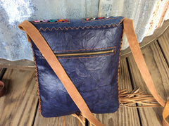 Leather fringed purse handwoven huipil and finished with top grain hand laced leather